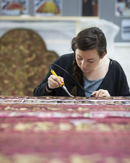 Detailed work on the spangled bed. Pictures: National Trust