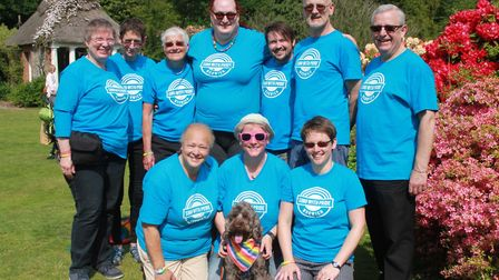 Sing with Pride choir pose for a photo at the Stody Lodge Gardens Big Gay Out. It was one of the eve