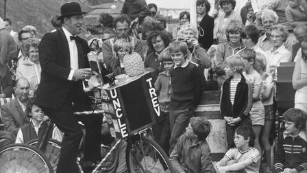 Cromer Carnival 1982: Uncle Trev and his tricycle entertain the crowds.Photo: Archant library