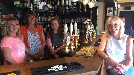 Linda Johnson, right, is the new landlady at the Crown in Smallburgh. With other staff members, from