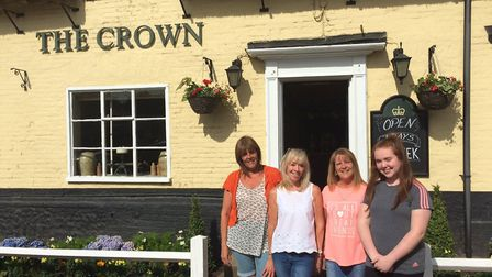 Linda Johnson, second from left, is the new landlady at the Crown in Smallburgh. With other staff me