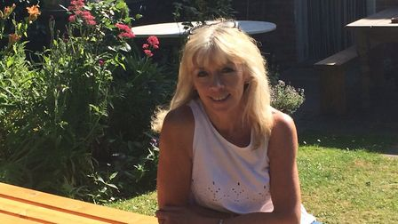 Linda Johnson, pictured in the garden, is the new landlady at the Crown in Smallburgh. Picture: Davi