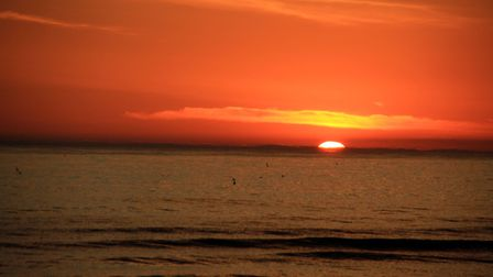 The sun rising over the sea at West Runton. Picture: JO JOHNS
