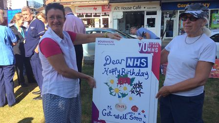 NHS 70th birthday in Cromer. Elaine Addison, left, and Beverley Broadhead with the birthday card. Pi