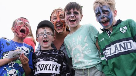 Showing off their face painted faces at the fourth Strand Festival, Sidestrand Hall School pupils fr