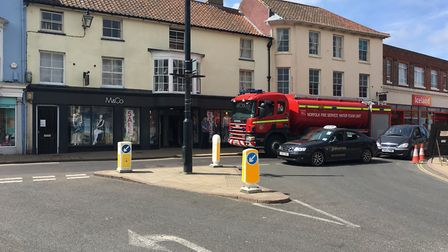 A Norfolk Fire and Rescue Crw rushes through the centre of Cromer on its way to the scene of the bla