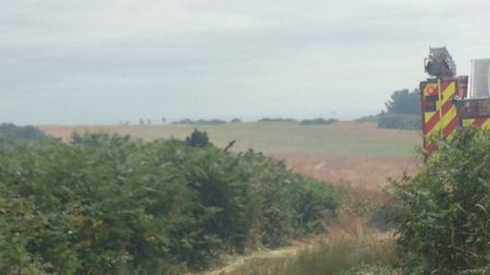 Smoke can be seen rising from the scene of the blaze near Cromer Lighthouse. Picture: DAVID BALE