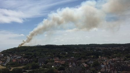 A thick column of smoke rises from the scene of the fire in Cromer. Picture: Jeremiah Williamson
