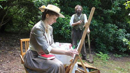 Sheringham Park Living History volunteers Charlotte Slade and Django Robinson playing an Edwardian l