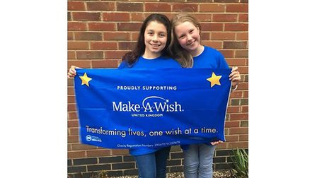 Lilly, left, and Libby before the shave. Picture: MAKE-A-WISH