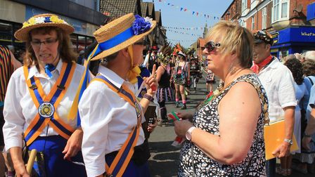 Sheringham mayor Madeleine Ashcroft handing out numbered wristbands to dancers taking part in the wo