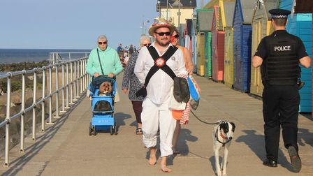 Daryl Coulborn, of Leicester Morris Men, taking a stroll on Sheringham prom with his dog Jack after