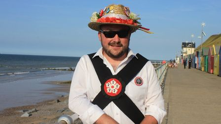 Daryl Coulborn, of Leicester Morris Men enjoing the sunshine on Sheringham prom after taking part in