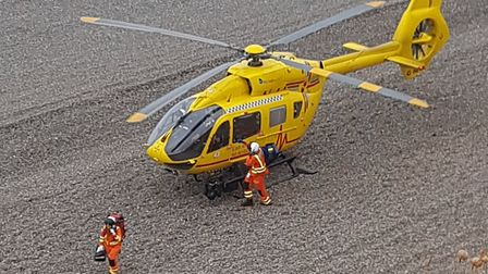 A paraglider was airlifed to hospital after reportedly colliding with cliffs at Weybourne in north N