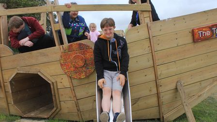 Woodfields student Bradley tries out the slide on Sheringham playground's newly-launched Viking ship
