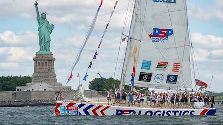 David Greer's team yacht passing the Statue of Liberty in New York. Picture: supplied by Marie Greer