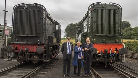 The handover at Weybourne on July 12. Photo: Leigh Caudwell