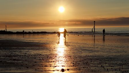 Capturing the last rays of a perfect day at Sheringham beach. Photo: Sue Sargeant
