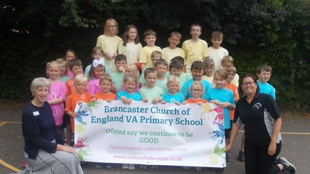 The Parents and Friends Association (PFA) presented the school with a celebratory banner. Photo: Bra