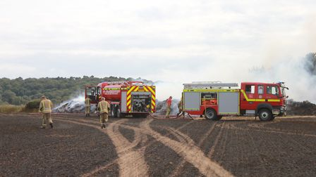 Firefighters tackling a series of fires that broke out in fields along Weybourne RoadPhoto: KAREN BE