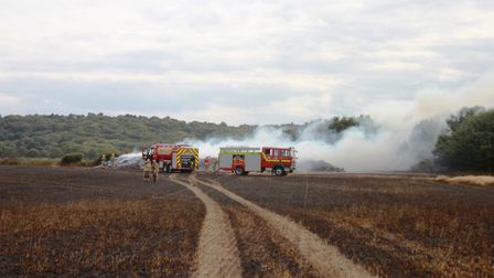 Fire crews damping down the flames at WeybournePhoto: KAREN BETHELL