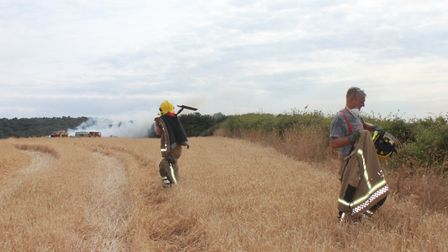 Firefighters heading for the blackened fields at WeybournePhoto: KAREN BETHELL