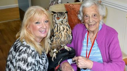Sandra Dalzell and owl with Heron Lodge resident Ruby Cragg. Picture: supplied by Stephen Pullinger