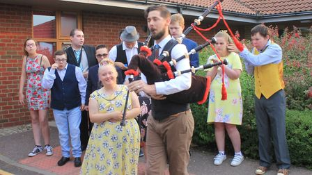 Sheringham Woodfields teacher Jacob Millin leads students into school for their leavers' prom Photo: