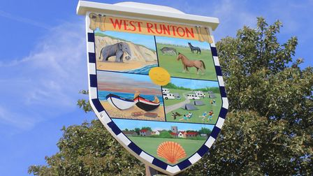 West Runton's newly-restored village sign, depicting the West Runton elephant, fishing boats and hor