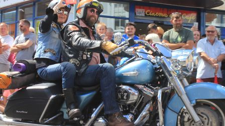 Harley Davidson motorcycles ride through Sheringham as part of a two-and-a-half mile convoy from Fak