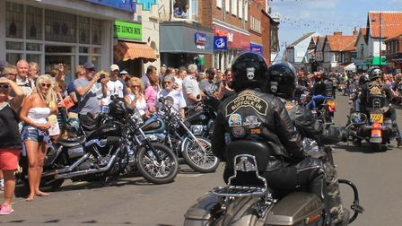 Harley Davidson motorcycles lined up along Sheringham high street.Photo: KAREN BETHELL