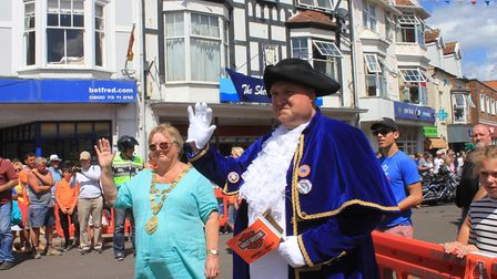 Sheringham mayor Madeleine Ashcroft and town crier Andrew Cunningham welcome the Harley Davidson con