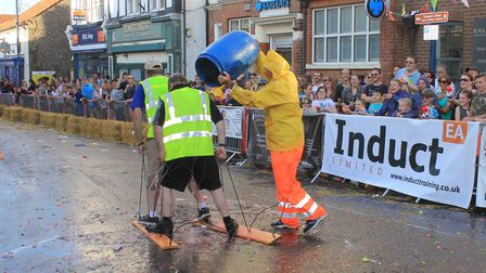 Sheringham Carnival events manager Graham Deans gets a soaking from carnival chairman Stuart McClean