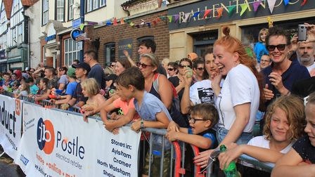 Spectators pelting competitors with flour and water at Sheringham Carnival street racesPhoto: KAREN