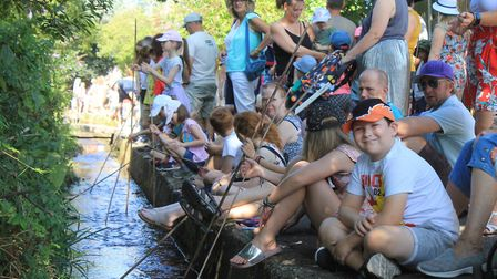 Watching the duck race from the banks of the stream behind Beeston Road.Photo: KAREN BETHELLPhoto: K