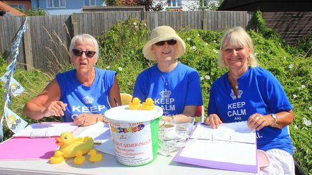 Carnival committee members selling numbers for the popular annual duck race.Photo: KAREN BETHELL