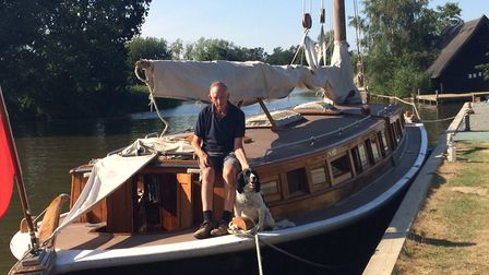 Peter Bower and his dog Sammy aboard the wherry, Hathor at How Hill. Pictures: David Bale
