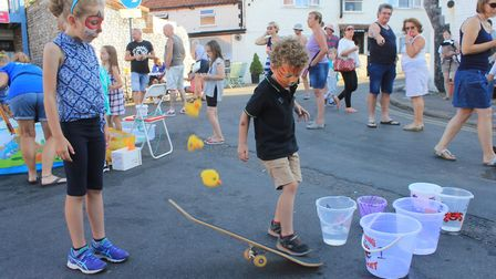 Youngster try their luck at flipping ducks from a skateboard at Sheringham Carnival finale.Photo: KA
