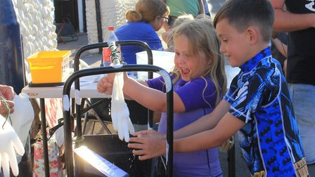 Youngsters having fun at a 'milk a cow' stall at Sheringham Carnival finale.Photo: KAREN BETHELL