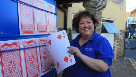 Carnival committee member Christine Hendry on the Play Your Cards Right stall.Photo: KAREN BETHELL
