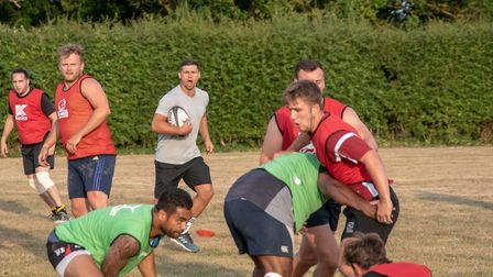 England star Ben Youngs keeps North Walsham players on their toes during a training session at Scott