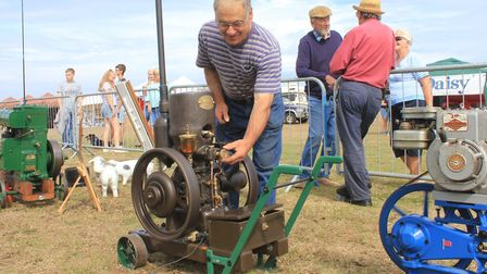 Starting Handle Club member Stephen Earl of North Walsham with his 1920s stationary engine.Photo: KA
