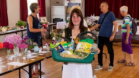 Sheila Mason holding the first raffle prize donated by the Poachers Pocket. Picture: DAVID MASON