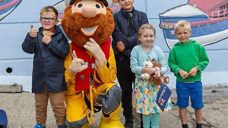 Young lifeboat day visitors pose for a photo with Sheringham RNLI mascot Stormy Stan. Photo: www.aer