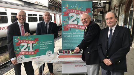 Marking the Bittern Line anniversary at Norwich Railway Station were, from left, Martin Halliday, Jo