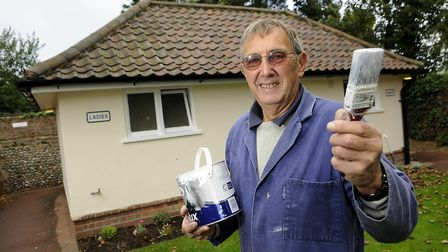 Town councillor John Allison outside the Holt public toilets, which werebeen brought back in to use