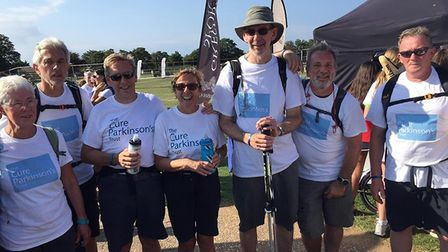 Tim Daber with his team of supporters. Photo: The Cure Parkinson's Trust