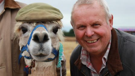 Ingworth Trosh organiser and founder Alan Witham poses with Luca the Alpaca. Photo: KAREN BETHELL
