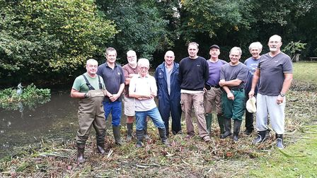 Roy Haynes, chairman of the Bluebell Pond Society (front, white shirt) and other volunteers during a