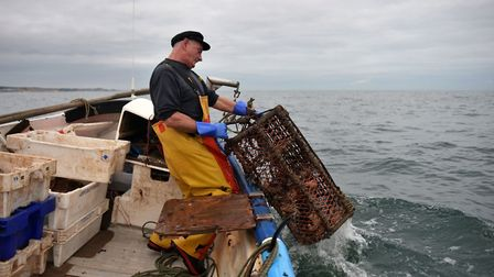 The father-of-four works 90 to 100 hours per week during the crab season. Photo: Joe Giddens/PA